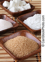 Sugar in wooden bowls - Wooden bowls with different kinds of...