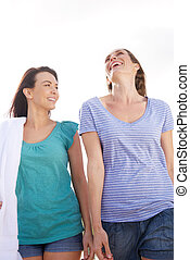 Two friends laughing outdoors