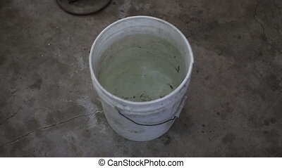 Cooling down metal after weld in a bucket of water