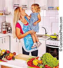 Mother feed child at kitchen - Mother feed her little...