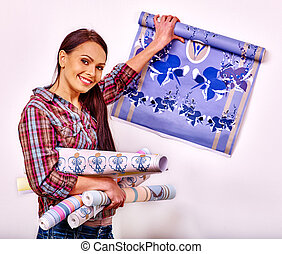 Happy woman glues wallpaper . - Happy woman going to glues...