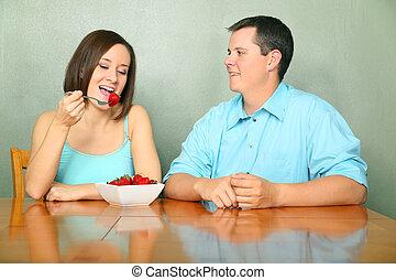 Caucasian Couple Talking On Kitchen Table