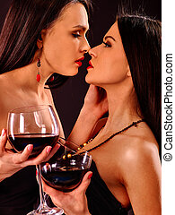 Women drinking red wine at nightclub. - Lesbian women...