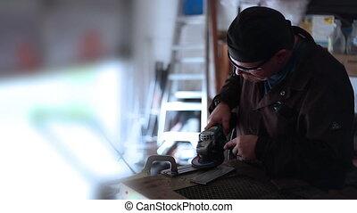 Man Smoking and grinding metal