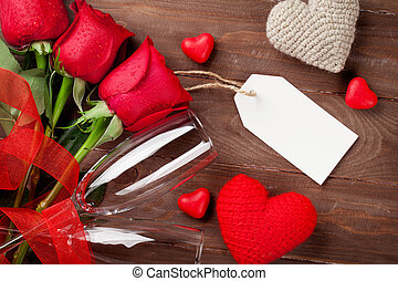 Valentines day red roses and champagne over wooden...