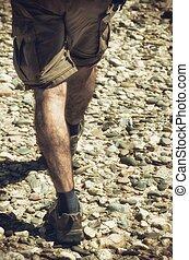 Hiker on Pebbles