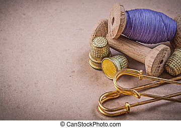 Spools of sewing threads thimbles clasp pins on vintage...