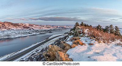 winter sunrise over Horsetooth Reservoir - panorama of...