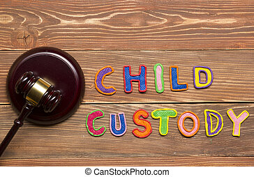 Judge gavel and colourful letters regarding child custody,...