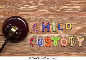 Judge gavel and colourful letters regarding child custody,...