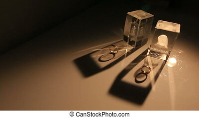 Golden wedding rings close up in pale yellow light - Wedding...