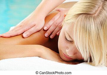 Young Woman In Spa - Close-up of a young woman receiving...