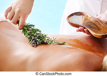 Spa Treatment - woman undergoing spa treatment with olive...