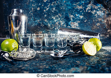 Alcoholic shots of tequila or strong drink in small glasses,...