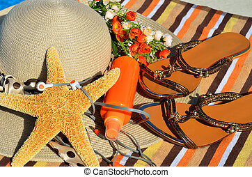 Beach hat, flip flops, head phones, sun spray. - Beach hat,...