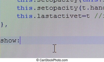 Close-up of computer code writing on desktop pc monitor