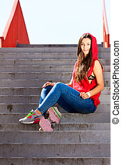 Summer sport. Cool girl skater riding skateboard - Summer...