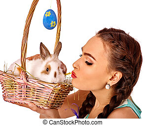 Woman in easter style holding rabbit  basket.