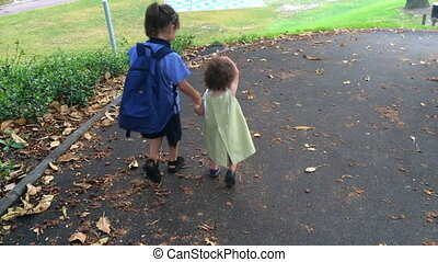 Two sisters going to school and kindergarten together.Family...