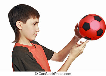 The teenager plays with a ball