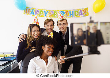 Business People Taking Selfie With Phone At Office Party -...