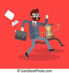 Business man running hour glass