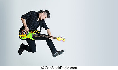 Rock and Roll - Awesome mohawk man jumps with his guitar in...