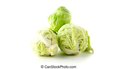Fresh brussels sprouts isolated on white background.
