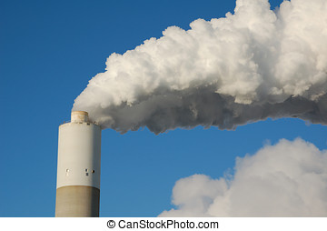 Smokestack - A power generating station pours out steam from...