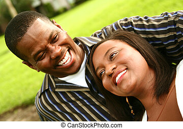 African American Couple Laughing Outdoor - african american...