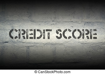 credit score stencil print on the grunge white brick wall