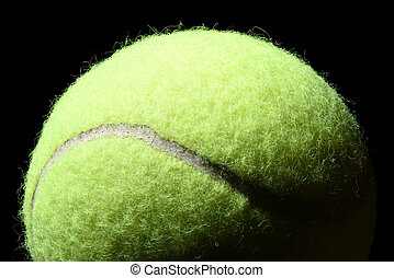 Tennis ball isolated on black background