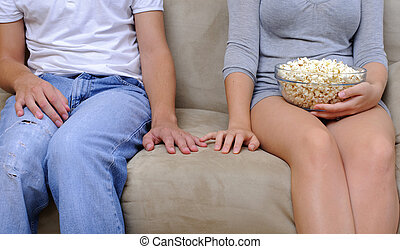 Closer - Couple watch a movie at home with popcorn