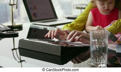 1 Multitasking Business Woman Mother And Daughter In Office...