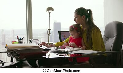 2 Mother With Child Entrepreneur Using Tablet In Office -...