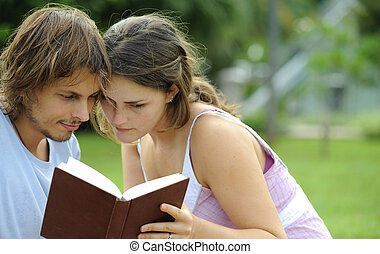 Poetry - Attractive couple read together in the park