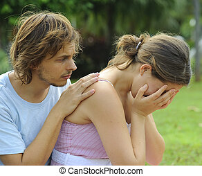What\'s the matter? - Man consoles his crying girlfriend in...