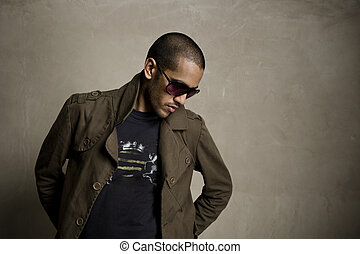 Brown tones - Fashion model blends in with the grunge wall...