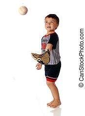 Preschool Catcher - A barefoot, preschooler in a baseball...