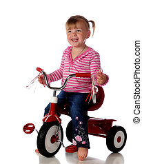 Happy Trike Rider - An adorable, barefoot two-year-old...