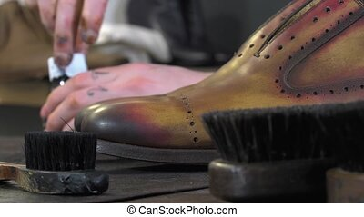 handmade coloring and care of shoes - Shoes and brushes in...
