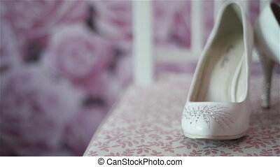 woman wedding shoes on the chair