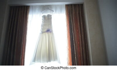 wedding dress in front of the window