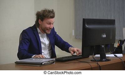 Active businessman rejoices success. In the office, sitting...