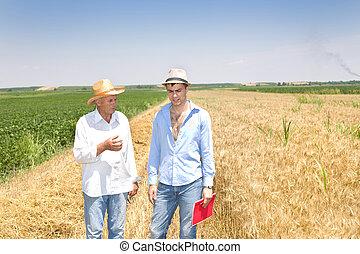 Two men in the field