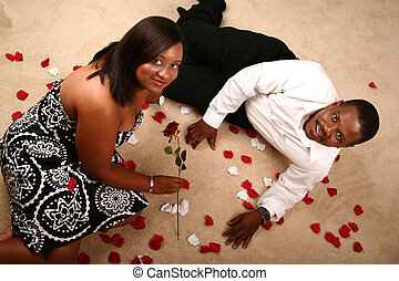 Romantic African American Couple Relaxing On The Floor