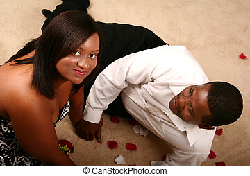 Happy African American Couple Relaxing On The Floor - happy...