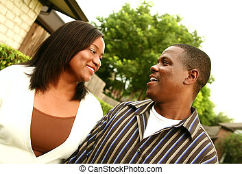 African American Couple With House Background 2 - african...