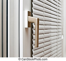 Aluminium blinds on the plastik window