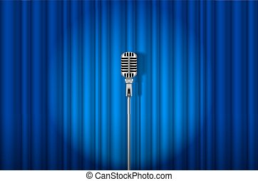 Microphone - Vintage Microphone against blue curtain with...